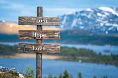 Free Trust Hope Love Text On Wooden Signpost Outdoors Stock Photos - 190113283