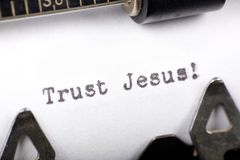 Trust Jesus. Typewriter close up shot, concept of Trust Jesus Stock Images
