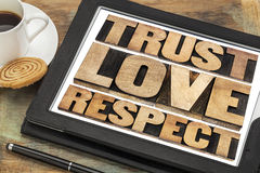 Trust, love and respect words. Trust, love and respect word abstract in vintage letterpress wood type on a digital tablet Royalty Free Stock Photo