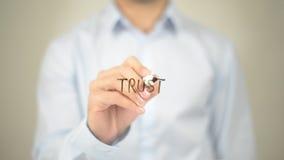 Trust, Man Writing on Transparent Screen Stock Photo
