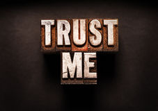 Trust Me. The phrase Trust Me in letterpress type. Cross processed, narrow focus Royalty Free Stock Photography