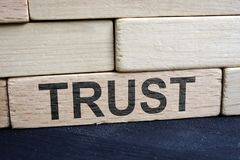 Trust and relationship. Wall from wooden bricks. Trust and relationship concept. Wall from wooden bricks stock photo