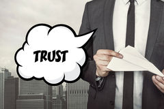 Trust text on speech bubble with businessman Stock Image