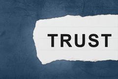 Trust with white paper tears Royalty Free Stock Photography