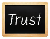 Trust - wooden chalkboard with text. On white background stock images