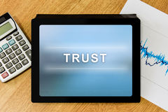 Trust word on digital tablet Stock Images