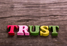 Trust word made of wooden letters Stock Photo