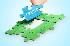 Trust word. Puzzle with Trust word piece Royalty Free Stock Images