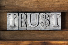 Trust word tray. Trust word made from metallic letterpress type on wooden tray Royalty Free Stock Photo