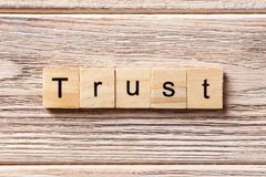 TRUST word written on wood block. TRUST text on table, concept.  Stock Images