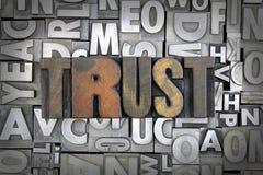 Trust. Written in vintage letterpress type Royalty Free Stock Images