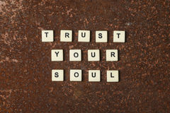 Trust your soul. Text on a rustic background Stock Photos