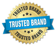 Trusted brand gold badge with blue ribbon Royalty Free Stock Photos
