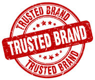 Trusted brand red grunge round vintage stamp Royalty Free Stock Image