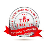 Trusted Brand. Top Quality, Voted by consumers - shiny metallic red icon / label / badge. Stock Photography