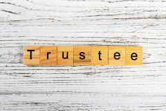 Trustee word made with wooden blocks concept stock image