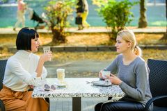 Trustful communication. Friendship sisters. Friendship meeting. Female leisure. Girls friends drink coffee talk. Conversation women cafe terrace. Friendship stock images