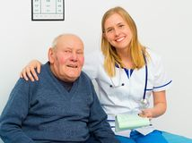 Trustful Young Doctor And Smiling Patient Stock Image
