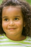 Trusting Eyes. Beautiful young girl child with big warm brown trusting eyes and soft loving smile Royalty Free Stock Images
