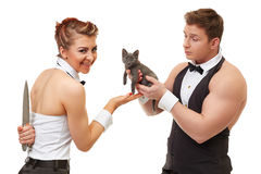 Trusting guy gives kitten to misleading girl Stock Photos
