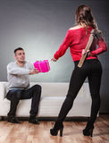 Trusting guy giving present to misleading girl Royalty Free Stock Photo