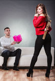 Trusting guy giving present to misleading girl Royalty Free Stock Photos