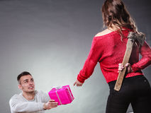 Trusting guy giving present to misleading girl Stock Image