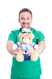 Trustworthy medic or  doctor holding plush bear Royalty Free Stock Photo
