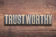 Trustworthy word wooden. Trustworthy word combined on vintage varnished wooden surface royalty free stock photography