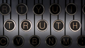 Truth. Image of old typewriter keyboard with scratched chrome keys that spell out the word TRUTH. Lighting and focus are centered on TRUTH Stock Images
