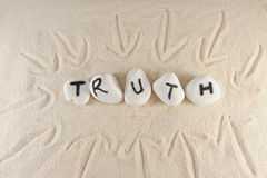 Truth. Word on group of stones on the sand royalty free stock photos