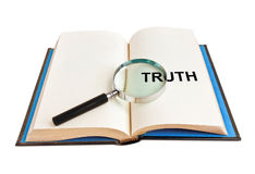 Truth book. Magnifying glass and word truth on book stock images