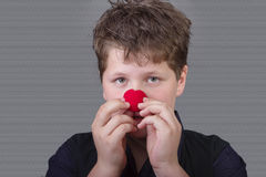 Truth - boy with red clown nose Stock Photography