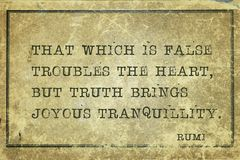 Truth brings Rumi. That which is false troubles the heart, but truth brings joyous tranquillity - ancient Persian poet and philosopher Rumi quote printed on royalty free stock images