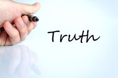 Truth concept. Pen in the hand  over white background Truth concept Stock Photos