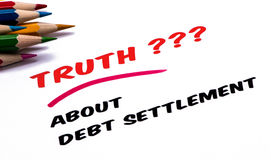 Truth about debt settlement. Handwritten on paper Royalty Free Stock Images