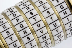 TRUTH - keyword set in combination puzzle box. Word TRUTH set as a secret keyword in a combination puzzle box with letter rings known as Cryptex Royalty Free Stock Photography