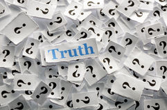 Truth. On question marks on white papers -hard light royalty free stock images