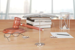 Truth scales with gavel, books and hourglass on wooden table Stock Photos