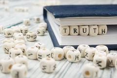 Truth word background on wood blocks. Wooden Abc Stock Photo