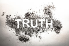 Truth word written in ash, dust, dirt or filth as a cynical concept of lie or post truth in society, politics. Truth word written in grey ash, dust, dirt or stock image