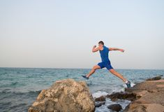 The truth is you can always run harder. Sometimes the truth hurts. Running man on beach. Runner training outdoors. Fit. Male sport fitness exercising. Running royalty free stock photography