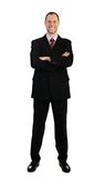 Trwanie biznesowy mężczyzna w kostiumu odizolowywającym na bielu Obraz Stock
