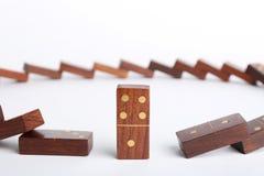 Trwanie domino kawałek wśród spadać ones na bielu zdjęcie royalty free