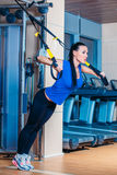 TRX. fitness, sports, exercise, technology and Royalty Free Stock Image