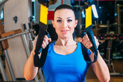 TRX. fitness, sports, exercise, technology and royalty free stock photo