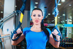 TRX. fitness, sports, exercise, technology and Stock Photo