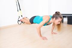 Trx legs exercise Stock Image