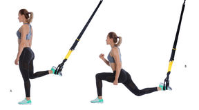 TRX lunge exercise. Athletic woman performing a functional exercise with suspension cable Royalty Free Stock Photography