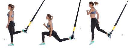 TRX lunge exercise with hop Royalty Free Stock Photos
